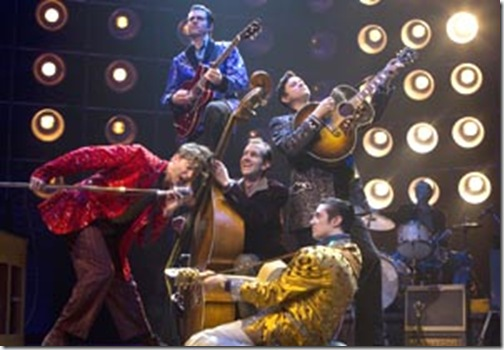 MILLION DOLLAR QUARTET - The new musical based on the night Johnny Cash, Jerry Lee Lewis, Carl Perkins, and Elvis Presley got together at Memphis' Sun Records for a legendary jam session. Pictured the Original Broadway Cast (L to R): Levi Kreis (on microphone) as 'Jerry Lee Lewis,' Robert Britton Lyons (standing on top of bass) as 'Carl Perkins,' Corey Kaiser playing bass, Eddie Clendening (kneeling) as 'Elvis Presley,' and Lance Guest (standing) as 'Johnny Cash.' © 2010, Joan Marcus.