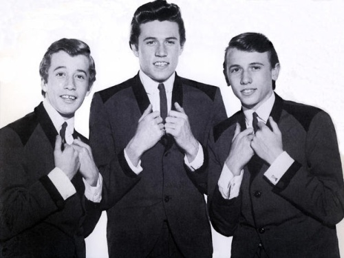 UNSPECIFIED - JANUARY 01: (AUSTRALIA OUT) Photo of The Bee Gees posed in Australia in 1964. Left to right: Robin Gibb, Barry Gibb and Maurice Gibb. (Photo by GAB Archive/Redferns)